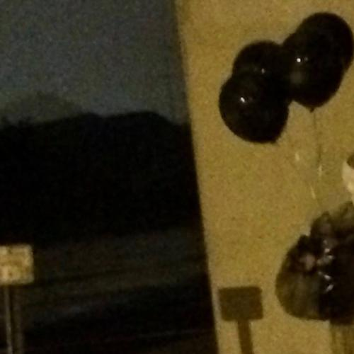 Creepy Clown With Black Balloons Seen Walking Through Town
