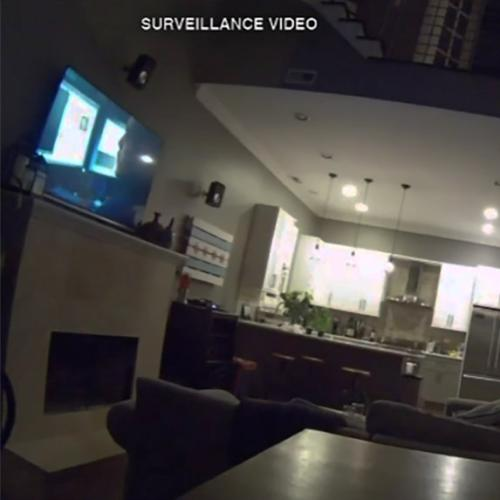 Couple's Security Footage Shows Intruder Watching Over Them